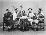 Four Chinese female musicians playing from left to right; a sanxian, a pipa, an erxian and an erhu